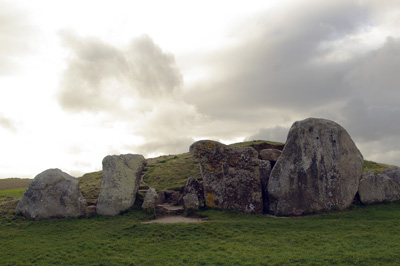 megalithic stones against a dazzling sky