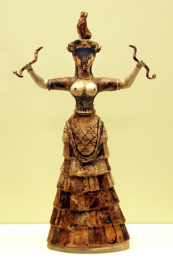 statuette of a Minoan woman holding two snakes